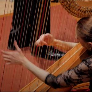 Yolanda playing harp